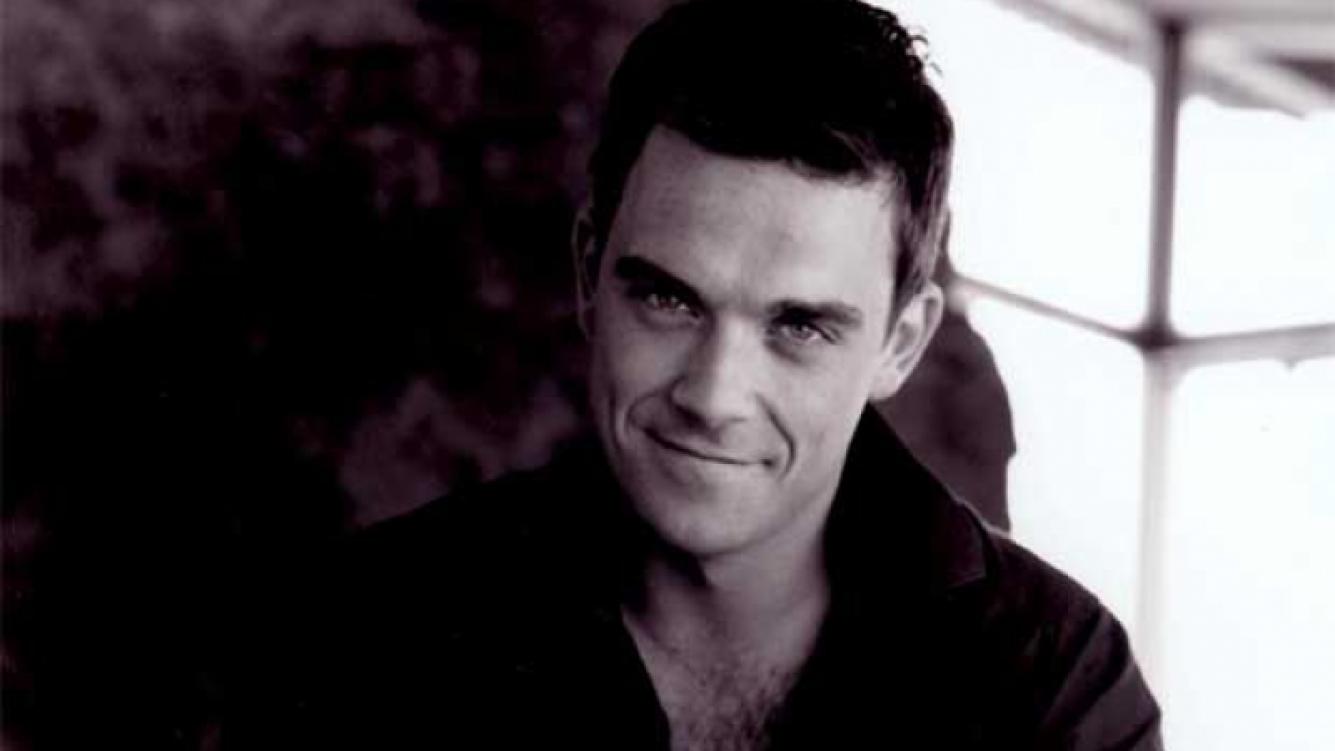 Robbie Williams quiere comprar una isla pare detectar Ovnis. (Foto: Web)