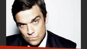 Robbie Williams debió pagar dos millones de dólares para poder abandonar Take That. (Foto: web)
